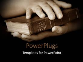 Elegant presentation design enhanced with pair hands holding well read Holy Bible