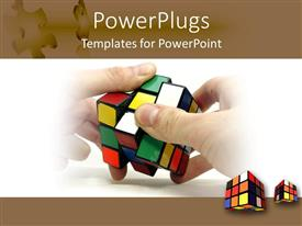 Colorful PPT theme having a pairof hands working on a rubix cube and two other cubes on the background