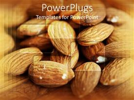 Audience pleasing presentation theme featuring pile of almonds on a brown background wooden surface