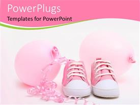 Colorful slide deck having pink shoes and balloons for a newborn girl