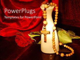 Elegant PPT theme enhanced with praying beads with a rose and vase on a red cloth
