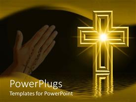 Slide deck with praying hands with rosary next to gold cross reflected on water with star in center