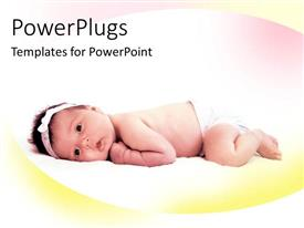 Colorful presentation design having pretty little baby lying face down on a soft surface