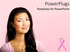 Amazing PPT theme consisting of pretty woman smiling on a pink background with breast cancer symbol