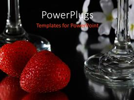 Presentation design consisting of red strawberries and wine glass on reflective black table