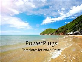 PPT theme enhanced with scenery of beach with ocean waves on beach sand and cloudy sky
