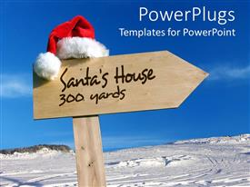 Elegant PPT theme enhanced with sign pointing way to Santa's house with snowy background and clear blue sky