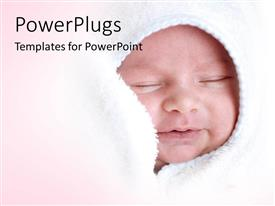 Slide deck consisting of a small baby smiling and wrapped with a white blanket