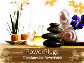 Colorful presentation theme having spa products with stones towels flasks and oil