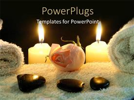 Beautiful PPT layouts with spa table with stones on white towel and two lighted candles