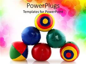 Presentation theme having stack of colorful juggling balls, rainbow dot background