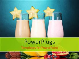 Colorful presentation having three glasses of milk shake with fruits on blue background