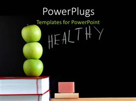 Presentation theme having three green apples on book pile with text HEALTHY on chalkboard