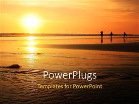 PPT theme having three people standing on Bali beach with beautiful sunset in horizon