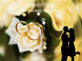 Slide set consisting of two golden wedding rings on a white rose and the shade of a kissing couple on an abstract background