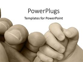 PPT theme featuring vintage black and white depiction of baby hand holding parent hand, parenting, child holding finger of adult