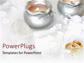 Presentation theme with wedding theme with two golden wedding rings, two silver lit candles white roses