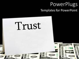 Theme having the word trust with bundles of dollars in the background