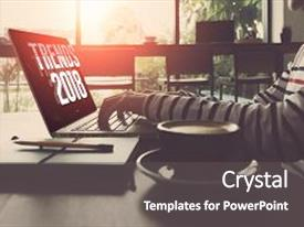 Colorful PPT theme enhanced with a laptop trends 2018 backdrop and a dark gray colored foreground.