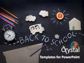 Beautiful presentation theme featuring back to school background with the child going to school application on a blackboard pencils scissors and alarm clock on the table view from above backdrop and a dark gray colored foreground.