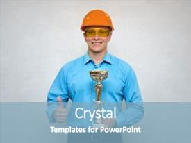 Amazing PPT theme having builder award best construction worker builder in a hardhat holding in one hand gold cup award trophy and showing thumbs up gesture sign by another hand worker of the year backdrop and a light blue colored foreground.