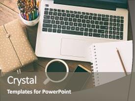 Beautiful PPT layouts featuring business accessory laptop and smart backdrop and a gray colored foreground.