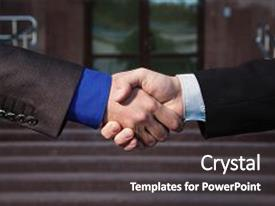 Beautiful PPT theme featuring business handshake agreement handshake on backdrop and a dark gray colored foreground.