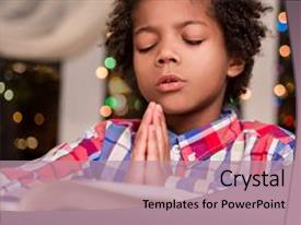 Beautiful PPT theme featuring children - afro child praying black kid backdrop and a coral colored foreground.