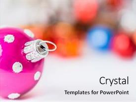 Audience pleasing presentation consisting of close-up of pink xmas ball with blurred colorful christmas decor in background christmas and new year concept with copy space christmas greeting card backdrop and a white colored foreground.