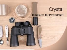 Slide deck with compass binoculars - equipment for trekking on wooden background and a lemonade colored foreground