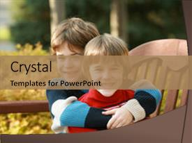 Cool new PPT theme with cute kids - brothers hugging sitting backdrop and a coral colored foreground.