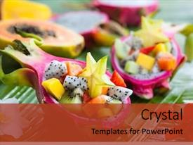 Cool new slides with exotic fruit salad served backdrop and a tawny brown colored foreground