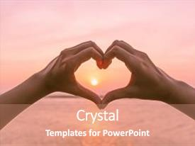 Amazing presentation having female hands in the form of heart against sunlight in sunset sky twilight time hands in shape of love heart love concept backdrop and a coral colored foreground.
