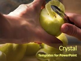 Presentation theme with female hands peeling skin off of green apple using a paring knife peel the skin off apples woman cuts off the peel of an apple garden apples golden apples farm products juicy fruit background and a tawny brown colored foreground.