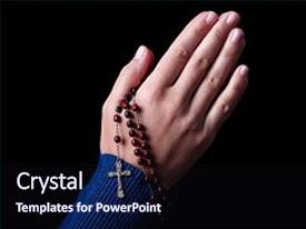 Presentation theme consisting of female hands praying holding a rosary with jesus christ in the cross or crucifix on black background woman with christian catholic religious faith background and a wine colored foreground.