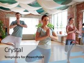 Cool new presentation theme with fitness meditation and healthy lifestyle concept - group of people doing yoga in tree pose at studio backdrop and a light gray colored foreground.
