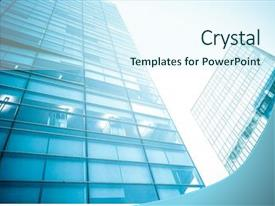 PPT theme having glass high rise building background and a cool aqua colored foreground