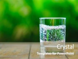 Presentation theme enhanced with glass of water on green background the wooden table pure water with gas sparkling water background and a gray colored foreground.