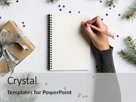 PPT layouts featuring goals plans dreams make to do list for new year christmas concept writing in notebook woman hand holding pen on notebook with fir branches gift on white background new year winter holiday xmas background and a light gray colored foreground.