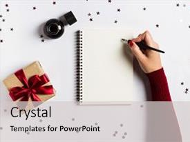 PPT layouts enhanced with goals plans dreams make to do list for new year christmas concept writing in notebook woman hand holding ink pen on notebook with gift red bow on white background new year winter holiday xmas background and a light gray colored foreground.