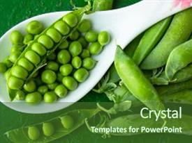 Cool new presentation theme with green peeled peas in a spoon on a green background green peas in the pods fresh green peas peeled peas backdrop and a tawny brown colored foreground.