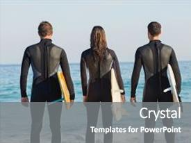Cool new PPT theme with group of friends on wetsuits with a surfboard on a sunny day at the beach backdrop and a gray colored foreground