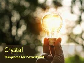 Cool new slide deck with hand holding light bulb and sunset in nature power energy concept backdrop and a tawny brown colored foreground.