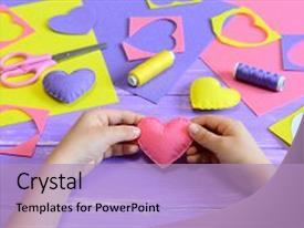 Presentation design featuring february - hands child shows heart crafts background and a light blue colored foreground.
