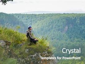 Theme having happy man with eyes closed sitting on the edge of a cliff meditating in yoga pose relax and leisure in harmony with nature background and a gray colored foreground.