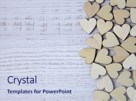 Audience pleasing PPT theme consisting of heart shape from natural tree lovely heart shape by wooden small hearts on rustic wood table love theme concept with wooden hearts for valentine s background and love theme wooden leters i love you backdrop and a sky blue colored foreground.