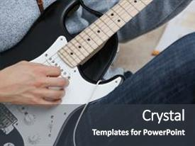 Cool new theme with male hands at home play and tune the electric guitar is engaged in music realizes listening enjoying music notation large concept closeup backdrop and a dark gray colored foreground.