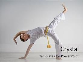 Amazing PPT theme having man practicing capoeira brazilian martial backdrop and a light gray colored foreground.