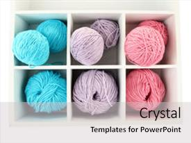 Presentation with yarn - multicolored clews in wooden box background and a light gray colored foreground