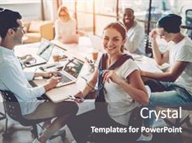 Beautiful slides featuring multiracial young creative people in modern office group of young business people are working together with laptop tablet smart phone notebook successful hipster team in coworking freelancers backdrop and a gray colored foreground.